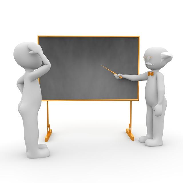učitel s žákem u tabule